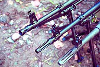 Щелевые пламегасители пулемётов (снизу-вверх): ПК, ПКМ ранних выпусков, ПКМ выпускающийся в настоящее время