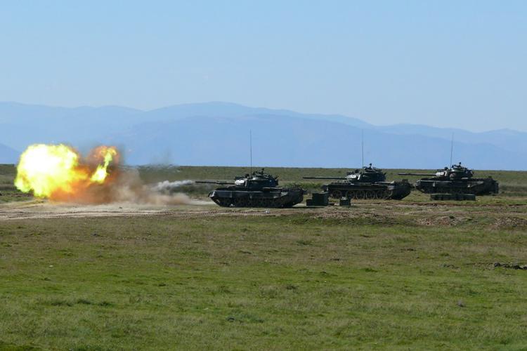 Танки Т-55М ведут огонь