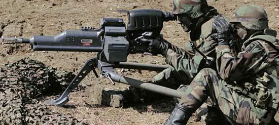 XМ307 при стрельбе