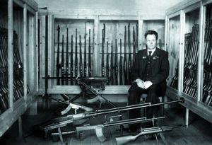 С.Г. Симонов на фоне коллекции своего оружия в НИИ-61. г. Климовск, 1953 г.