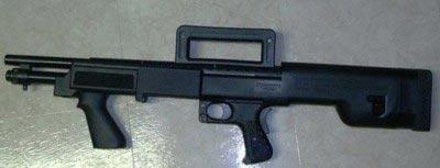 Помповое ружье Mossberg М500 в фирменной пластиковой ложе компоновки буллпап