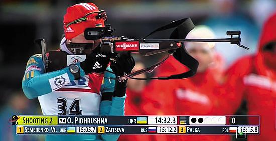 Елена Пидгрушная, олимпийская чемпионка 2014 года в эстафете, и ее биатлонная винтовка калибра .22 LR