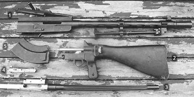 Части неполной разборки пулемета L/S-26 1 – короб и кожух пулемета; 2 – затыльник с прикладом; 3 – ствол со ствольной коробкой; 4 – затвор; 5 – магазин