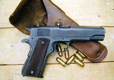 Пистолет Кольт М 1911А1 с патронами .45 АСР