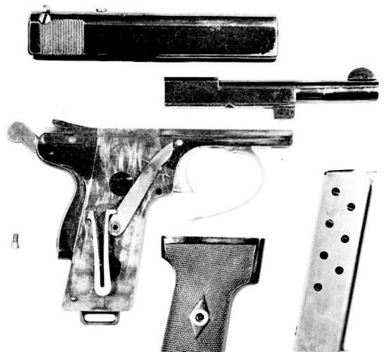 Webley & Scott M 1909 (неполная разборка). На рукоятке хорошо видны V-образная возвратная пружина и рычаг, связывающий ее с затвором, которые закрываются щечкой.