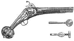 Пистолет с колесцовым замком XVI в. Рядом — ключи для завода пружин замков