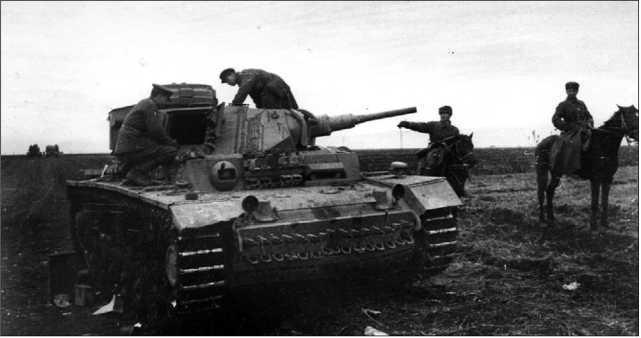 Немецкий танк Pz.III Ausf.J, подбитый экипажем гвардии младшего лейтенанта В.А. Рубцова. Северо-Кавказский фронт, январь 1943 года.