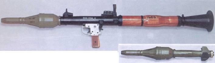 Ручной противотанковый гранатомет РПГ-4 и кумулятивная граната.