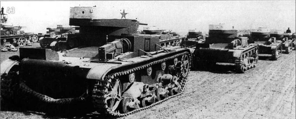 Т-26 на учениях Киевского военного округа. Верхняя половина башни танка окрашена в белый цвет с красной звездой на борту. 1935 г.