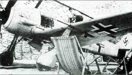 Fw 190А-6, коричневая «I + — », принадлежавший командиру 2./JG 26 капитану Гансу Науманну, Витри-ан-Артуа, Франция, июль 1943 года.