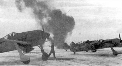 Конец марта 1943 года. После долгой и суровой русской зимы на аэродромах в Орле (JG 51) и Красногвардейске появились первые признаки наступающей весны. Зимний камуфляж с самолетов частью облез, частью смыт, лишь на «белой 3» видны последние белые пятна. Такой камуфляж отлично растворял самолет на фоне весенних проталин. Взлетная полоса по прежнему покрыта утрамбованным снегом, а это значит, что температура все еще колеблется в районе 0 гр. Источник густого дыма, валящего па заднем плане, неизвестен.