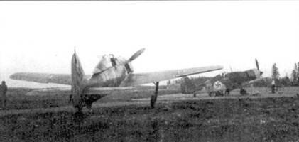 После ремонта «белая 4» ожидает аэродромных испытаний, лишь после их успешного завершения машину допустят к боевым вылетам. Виден еще один истребитель финских ВВС, на этот раз Fiat G.50. За один месяц пребывания в Иммоле I1./JG 54 заявила 66 побед.