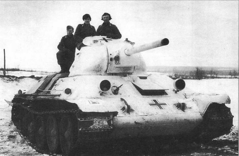 Трофейный танк Т-34 из состава 98-й пехотной дивизии Вермахта. Восточный фронт, 1942 год