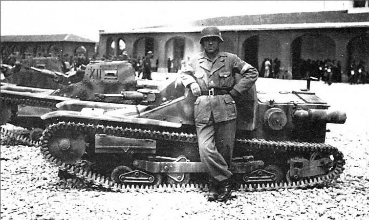 Немецкий военнослужащий позирует на фоне танкеток L3. 1943 год
