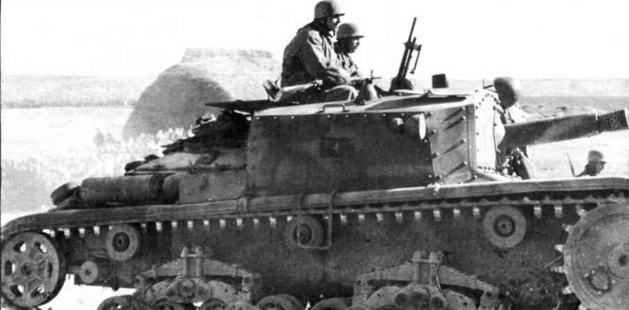 Итальянское <a href='https://arsenal-info.ru/b/book/2995468144/5' target='_self'>самоходное орудие</a> Semovente da 75/18. Судя по характерной форме шлемов на головах членов ее экипажа, эта машина принадлежит к составу немецкой парашютно-<a href='https://arsenal-info.ru/b/book/1627328415/38' target='_self'>танковой дивизии</a> «Герман Геринг». Италия, 1944 год