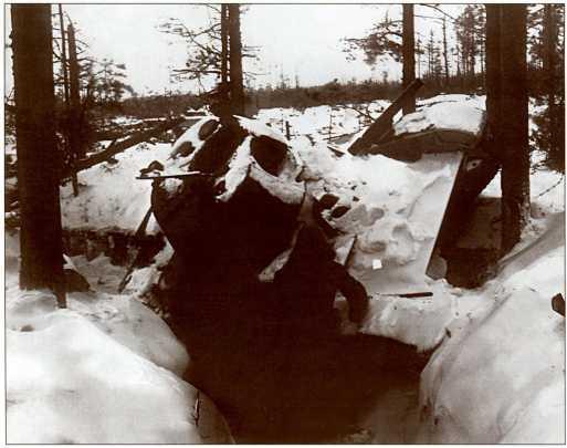 Подбитый Т-26 в противотанковом рву.