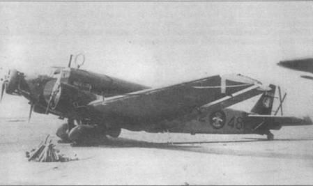 Ju-52/3m g3e (22–48) из 2-й ночной бомбардировочной группы. Группы легко установить по коду на вертикальном оперении — 2-G-22. Ниже кода — эмблема группы: три крылатых слона. На борту самолета сразу за кабиной белой краской написано собственное машины — «А VARRA». Опознавательные знаки — круги черного цвета с изображением фаланги, сделанным красной краской.
