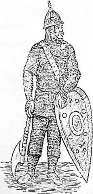Русский воин с боевым топором. Туловище и ноги защищает кольчуга. На голове шлем-шишак с острым верхом. Щит продолговатый, с округлым верхом и заостренным низом