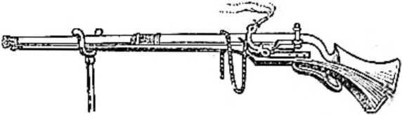 Аркебуза. Слева видна подставка. На нее опирается аркебуза при стрельбе
