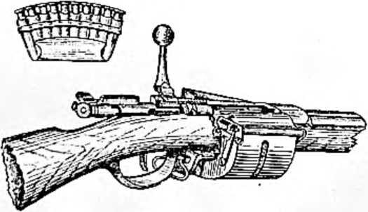 Одна из первых магазинных винтовок. Магазин окружает винтовку снизу. В нем помещается двенадцать патронов. Вверху — магазин оружейника Крнка