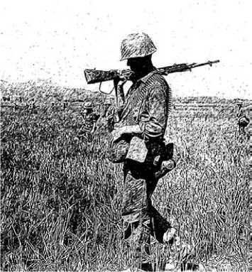 Американский морской пехотинец, вооруженный винтовкой М14.