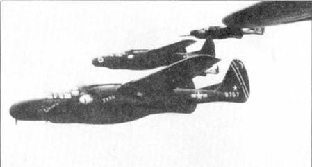 Звено «Вдов» возглавляет истребитель «WANDA 'ER/FRAN» — P-61B-15 серийный номер 43-9757. Все самолеты принадлежат 418 NFS. Снимок сделан летом 1945г. над Окинавой. Название «WANDA'ER/ FRAN» написано желтой краской, коки винтов — бело-голубые.