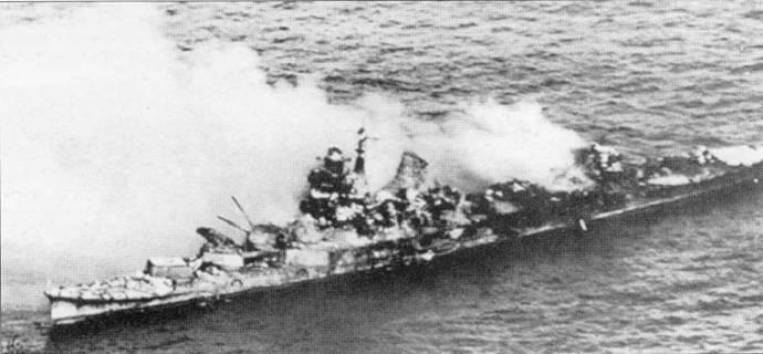 Агония крейсера «Микума», вечер 7 июня 1942г. На юте растянут тент. Взрывами торпед разворочена вся средняя часть тяжелого крейсера.