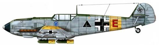 Bf 109Е-7/В из 2./SG 1, русский фронт, 1941 г. На борту самолета изображен нагрудный штурмовой пехотный знак (Sturmabzeichen). Верхние поверхности: RLM 71 /02. Нижние поверхности: RLM 65. Самолет оснащен пилоном ЕТС 50 и четырьмя 50-кг бомбами SC 50 с желтым оперением.
