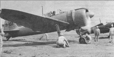 КА-103 – ранний самолет «модель II», из Касумигаура (учебного) кокутай. Самолет целикам окрашен в светло-серый цвет, передние кромки крыла в районе центроплана – желтооранжевые. На капоте двигателя накрашена антибликовая полоса черного цвета.