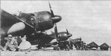 Линейка истребителей «Зеро» модель 52b. На киле второго слева самолета надпись: «221-16 Zi».