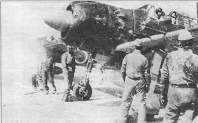 A6M5c модель 52c из Ютабе кокутай готовят к боевому вылету на сопровождение камикадзе, которым предстоит нанести удар по американскому десанту на Окинаву. «Зеро» модель 52с получил два дополнительных крыльевых 13-мм пулемета, по одному в каждой плоскости с внешней стороны пушек.