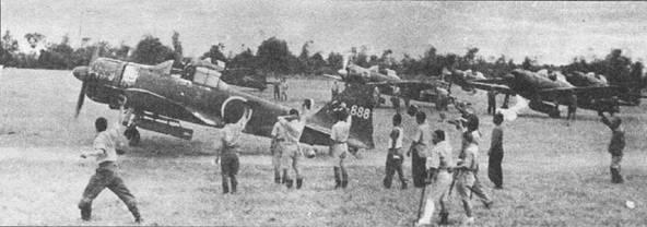 Вполне возможно, что на этом снимке запечатлен первый взлет камикадзе из 201-го кокутай, авиабазы Мабаракат, Филиппины, 25 октября 1944 г. Ни вооружении первого подразделения камикадзе «Шинкигима-Тай» состояли самолеты A6M2 и A6M5. Командовал им лейтенант Юкио Секи, возможно самолет с бортовым кодом «02-888» – машина Секи. В первых налетах камикадзе принимали участие только добровольцы, затем в камикадзе стали зачислять летчиков в приказном порядке.