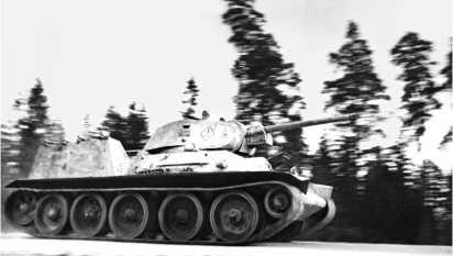 Танк Т-34 с установленными на надгусеничных полках фугасными огнеметами ФОГ-1. 1942 год.