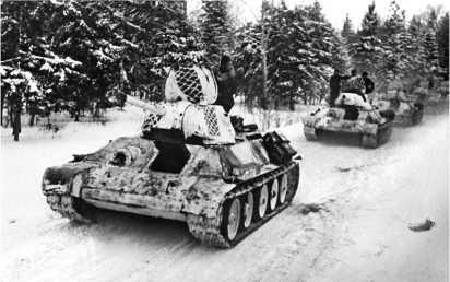 Танки 1-й гвардейской танковой бригады на марше. Март 1942 года.