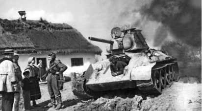 Танк Т-34 в освобожденной деревне на Буковине. 1-й Украинский фронт, 1944 год.