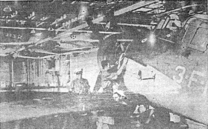 Механики обслуживают «Wildcat» в ангаре «Enterprise». Остальные самолеты подвешены к потолку для высвобождения места