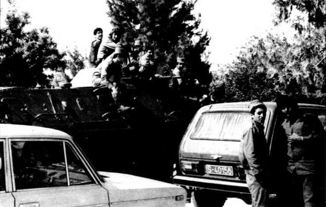 Бронетранспортер БТР-60ПБ одного из подразделений Царандоя (афганская военизированная милиция) на улице г.Мазари-Шариф на севере Афганистана, 1982 год.