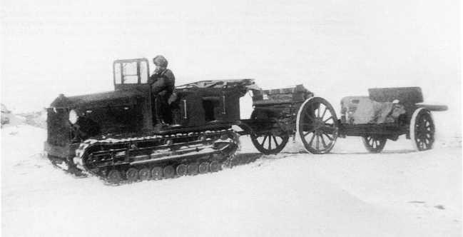 Японский артиллерийский тягач Тип 92 (5-тонный) со 105-мм пушкой «образца 14 года» (1935г.) на прицепе. Маньчжурия, зима 1938 года (АСКМ)