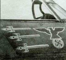 Правый борт «Харрикейна I» (Y В-N, Р3878) 17-й эскадрильи, принадлежавшего взводному офицеру Берд-Уилсону. Офицер сражался во Франции, затем участвовал в Битве за Англию. Англичанин был сбит самим майором Адольфом Голландом, став его 40-й жертвой.