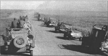 Бесконечные колонны 13-й танковой дивизии едут по пыльным дорогам в направлении Кавказа.