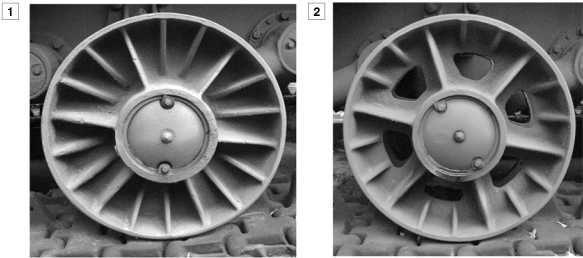 Цельнолитые опорные катки танков КВ-1: 1 — сплошной с ребрами жесткости; 2 — облегченный с ребрами жесткости и вырезами в диске, встречается на машинах выпуска декабря 1941-го — января 1942 года.